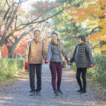 WIth her parents, enjoying red maple leaves with our photographer. Kyoto, Japan